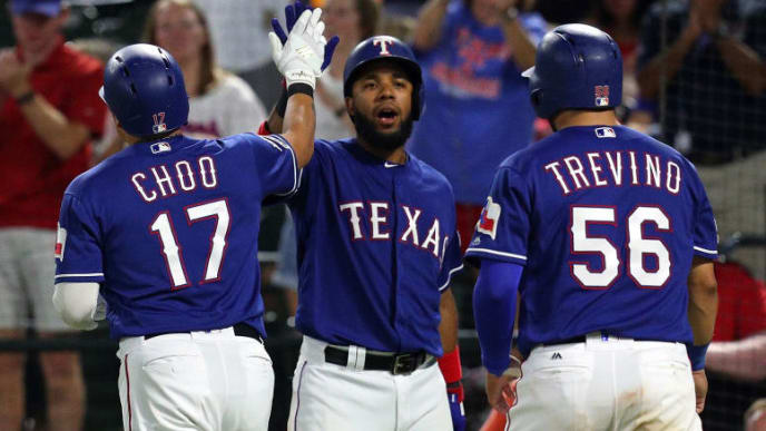 ARLINGTON, TEXAS - SEPTEMBER 27: Elvis Andrus #1 of the Texas Rangers greets Shin-Soo Choo #17 and Jose Trevino #56 after they scored on Choo's ninth inning home run against the New York Yankees at Globe Life Park in Arlington on September 27, 2019 in Arlington, Texas. (Photo by Richard Rodriguez/Getty Images)