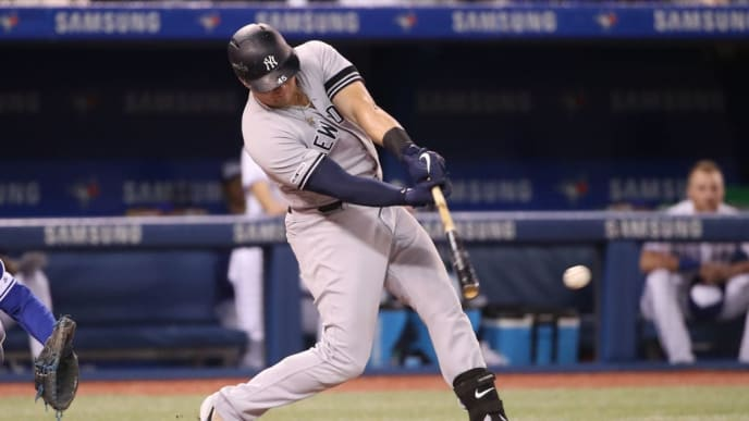 TORONTO, ON - JUNE 04:  Luke Voit #45 of the New York Yankees hits a single in the fifth inning during MLB game action against the Toronto Blue Jays at Rogers Centre on June 4, 2019 in Toronto, Canada. (Photo by Tom Szczerbowski/Getty Images)
