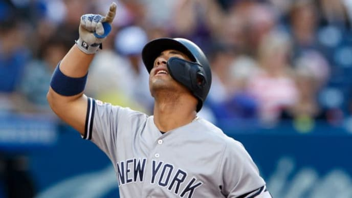 TORONTO, ON - SEPTEMBER 14: Gleyber Torres #25 of the New York Yankees celebrates as he touches the plate on a two run home run in the sixth inning of their MLB game against the Toronto Blue Jays at Rogers Centre on September 14, 2019 in Toronto, Canada. (Photo by Cole Burston/Getty Images)