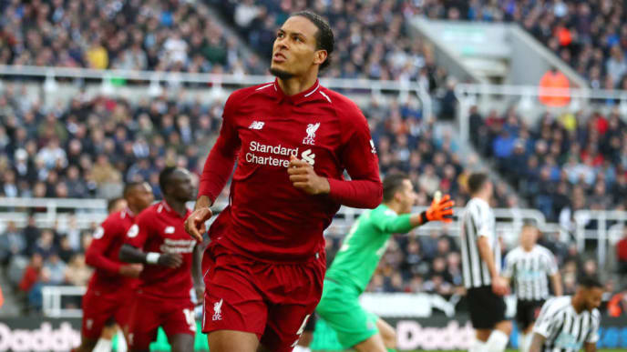 NEWCASTLE UPON TYNE, ENGLAND - MAY 04: Virgil van Dijk of Liverpool celebrates after scoring his team's first goal during the Premier League match between Newcastle United and Liverpool FC at St. James Park on May 04, 2019 in Newcastle upon Tyne, United Kingdom. (Photo by Clive Brunskill/Getty Images)