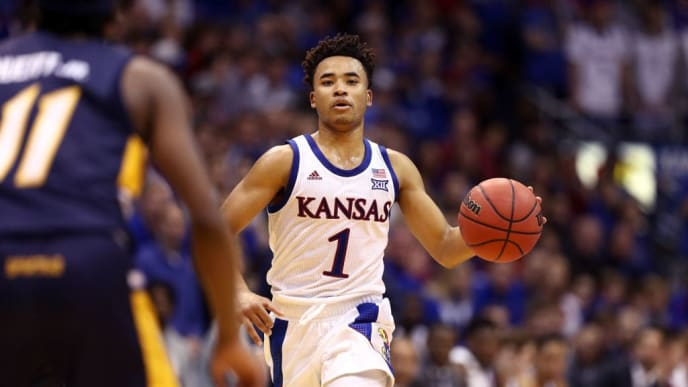 LAWRENCE, KANSAS - NOVEMBER 08:  Devon Dotson #1 of the Kansas Jayhawks controls the ball during the game against the UNC-Greensboro Spartans at Allen Fieldhouse on November 08, 2019 in Lawrence, Kansas. (Photo by Jamie Squire/Getty Images)