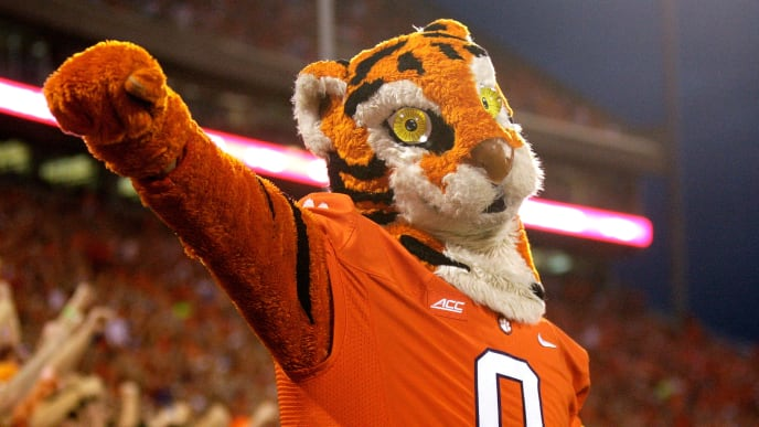 CLEMSON, SC - SEPTEMBER 27: The Clemson Tiger mascot cheers on with fans during the game against the North Carolina Tar Heels at Memorial Stadium on September 27, 2014 in Clemson, South Carolina. (Photo by Tyler Smith/Getty Images)
