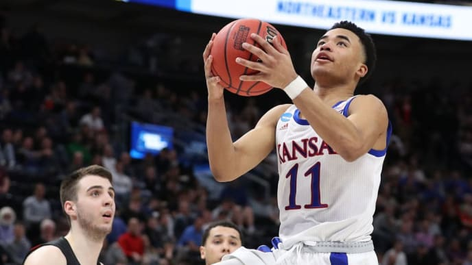 SALT LAKE CITY, UTAH - MARCH 21: Devon Dotson #11 of the Kansas Jayhawks drives to the basket during the second half against the Northeastern Huskies in the first round of the 2019 NCAA Men's Basketball Tournament at Vivint Smart Home Arena on March 21, 2019 in Salt Lake City, Utah. (Photo by Patrick Smith/Getty Images)
