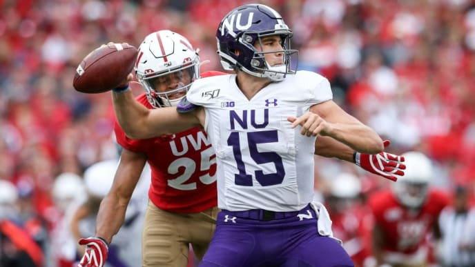 MADISON, WISCONSIN - SEPTEMBER 28:  Eric Burrell #25 of the Wisconsin Badgers forces a fumble against Hunter Johnson #15 of the Northwestern Wildcats in the third quarter at Camp Randall Stadium on September 28, 2019 in Madison, Wisconsin. (Photo by Dylan Buell/Getty Images)
