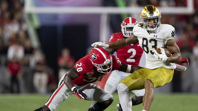 ATHENS, GA - SEPTEMBER 21: Chase Claypool #83 of the Notre Dame Fighting Irish is tackled by J.R. Reed #20 of the Georgia Bulldogs after a reception during a game between Notre Dame Fighting Irish and University of Georgia Bulldogs at Sanford Stadium on September 21, 2019 in Athens, Georgia. (Photo by Steve Limentani/ISI Photos/Getty Images).