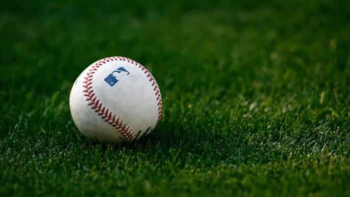 LOS ANGELES, CA - JUNE 16:  A baseball rests on the grass prior to the game between the Oakland Athletics and the Los Angeles Dodgers at Dodger Stadium on June 16, 2009 in Los Angeles, California.  (Photo by Jeff Gross/Getty Images)
