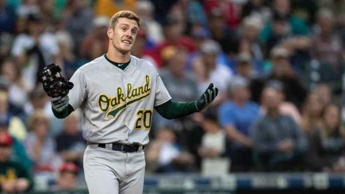 SEATTLE, WA - JULY 5: Mark Canha #20 of the Oakland Athletics protests to an umpire after an at-bat during the fourth inning of a game against the Seattle Mariners at T-Mobile Park on July 5, 2019 in Seattle, Washington. (Photo by Stephen Brashear/Getty Images)