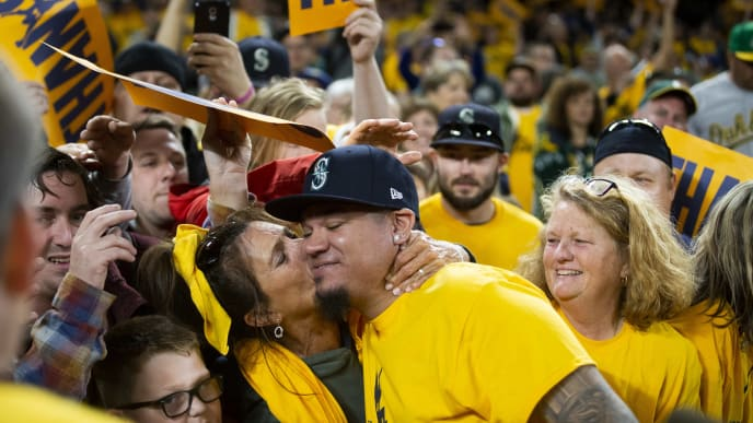 SEATTLE, WA - SEPTEMBER 26:  Fan Marianne Mingione kisses Felix Hernandez #34 of the Seattle Mariners as he greets fans after his last game with the Mariners at T-Mobile Park on September 26, 2019 in Seattle, Washington. The Oakland Athletics beat the Seattle Mariners 3-1. (Photo by Lindsey Wasson/Getty Images)