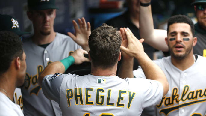 ARLINGTON, TX - JUNE 9: Josh Phegley #19 of the Oakland Athletics celebrates with teammates after scoring a run against the Texas Rangers during the ninth inning at Globe Life Park in Arlington on June 9, 2019 in Arlington, Texas. The Athletics won 9-8. (Photo by Ron Jenkins/Getty Images)