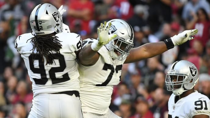 GLENDALE, AZ - NOVEMBER 18:  Maurice Hurst #73 of the Oakland Raiders celebrates a sack with P.J. Hall #92 in the first half of the NFL game against the Arizona Cardinals at State Farm Stadium on November 18, 2018 in Glendale, Arizona.  (Photo by Jennifer Stewart/Getty Images)
