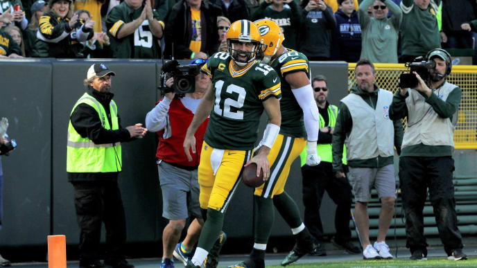 GREEN BAY, WISCONSIN - OCTOBER 20:  Aaron Rodgers #12 of the Green Bay Packers celebrates after scoring a touchdown in the third quarter against the Oakland Raiders at Lambeau Field on October 20, 2019 in Green Bay, Wisconsin. (Photo by Dylan Buell/Getty Images)