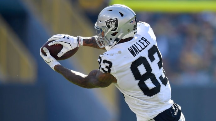GREEN BAY, WISCONSIN - OCTOBER 20: Darren Waller #83 of the Oakland Raiders catches the football against the Green Bay Packers at Lambeau Field on October 20, 2019 in Green Bay, Wisconsin. (Photo by Quinn Harris/Getty Images)