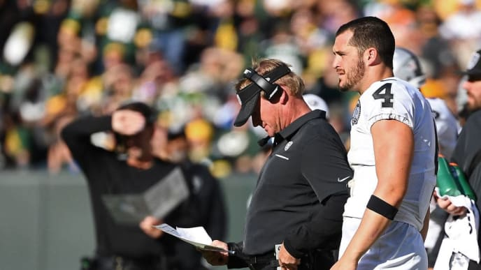 GREEN BAY, WISCONSIN - OCTOBER 20:  Derek Carr #4 and head coach Jon Gruden of the Oakland Raiders stand on the sidelines during a game against the Green Bay Packers at Lambeau Field on October 20, 2019 in Green Bay, Wisconsin. (Photo by Stacy Revere/Getty Images)