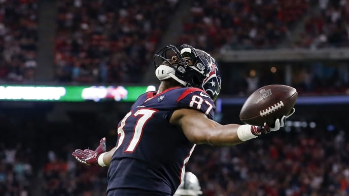 HOUSTON, TX - OCTOBER 27:  Darren Fells #87 of the Houston Texans reacts after a fourth quarter touchdown against the Oakland Raiders at NRG Stadium on October 27, 2019 in Houston, Texas.  (Photo by Tim Warner/Getty Images)