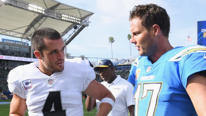 CARSON, CA - OCTOBER 07:  Derek Carr #4 of the Oakland Raiders and Philip Rivers #17 of the Los Angeles Chargers talk after a 26-10 Charger win at StubHub Center on October 7, 2018 in Carson, California.  (Photo by Harry How/Getty Images)