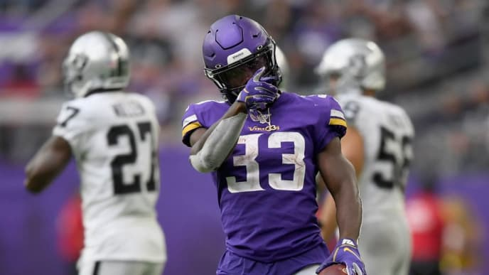 MINNEAPOLIS, MINNESOTA - SEPTEMBER 22: Dalvin Cook #33 of the Minnesota Vikings celebrates a first down against the Oakland Raiders during the third quarter of the game at U.S. Bank Stadium on September 22, 2019 in Minneapolis, Minnesota. (Photo by Hannah Foslien/Getty Images)