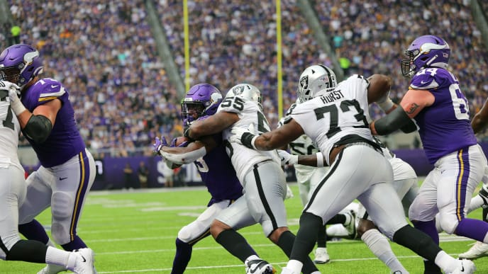 MINNEAPOLIS, MN - SEPTEMBER 22: Dalvin Cook #33 of the Minnesota Vikings scores a touchdown against Vontaze Burfict #55 of the Oakland Raiders in the second quarter at U.S. Bank Stadium on September 22, 2019 in Minneapolis, Minnesota. (Photo by Adam Bettcher/Getty Images)