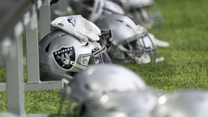 MINNEAPOLIS, MN - SEPTEMBER 22: Helmets and gear on the Oakland Raiders sideline before the game against the Minnesota Vikings at U.S. Bank Stadium on September 22, 2019 in Minneapolis, Minnesota. (Photo by Stephen Maturen/Getty Images)