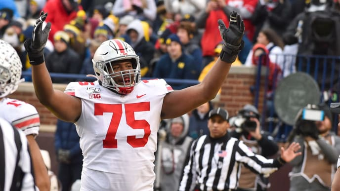 ANN ARBOR, MICHIGAN - NOVEMBER 30: Thayer Mumford #75 of the Ohio State Buckeyes celebrates a touchdown during the second half of a college football game against the Michigan Wolverines at Michigan Stadium on November 30, 2019 in Ann Arbor, MI. The Ohio State Buckeyes won the game 56-27 over the Michigan Wolverines. (Photo by Aaron J. Thornton/Getty Images)