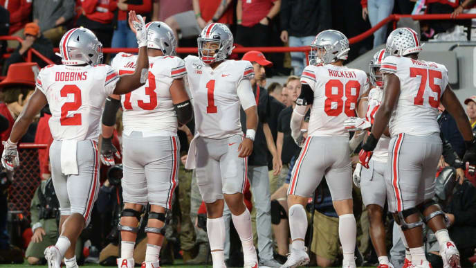 LINCOLN, NE - SEPTEMBER 28: Quarterback Justin Fields #1 of the Ohio State Buckeyes celebrates a touchdown with running back J.K. Dobbins #2 and offensive lineman Jonah Jackson #73 and tight end Jeremy Ruckert #88 and offensive lineman Thayer Munford #75 against the Nebraska Cornhuskersat Memorial Stadium on September 28, 2019 in Lincoln, Nebraska. (Photo by Steven Branscombe/Getty Images)
