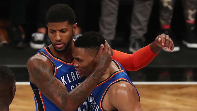 NEW YORK, NY - DECEMBER 05:  Paul George #13 of the Oklahoma City Thunder celebrates the winning three point shot with Russell Westbrook #0 in the final seconds of the game defeating the Brooklyn Nets 114-112 during their game at the Barclays Center on December 5, 2018 in New York City.  (Photo by Al Bello/Getty Images)