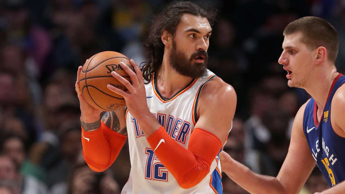DENVER, COLORADO - DECEMBER 14: Steven Adams #12 of the Oklahoma City Thunder is guarded by Nikola Jokic #15 of the Denver Nuggets at the Pepsi Center on December 14, 2018 in Denver, Colorado. NOTE TO USER: User expressly acknowledges and agrees that, by downloading and or using this photograph, User is consenting to the terms and conditions of the Getty Images License Agreement.  (Photo by Matthew Stockman/Getty Images)