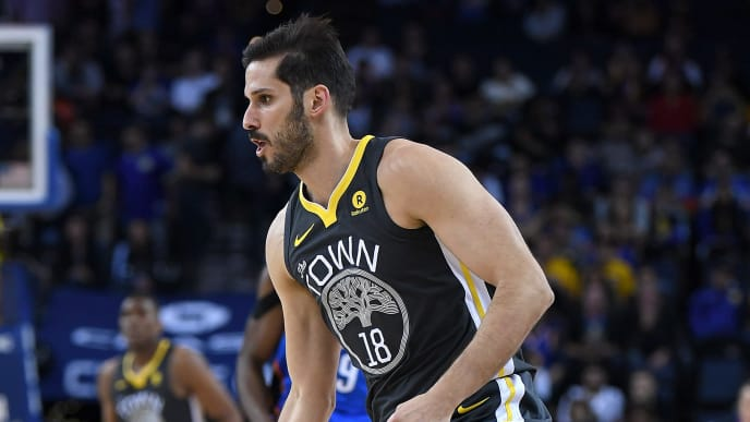 OAKLAND, CA - FEBRUARY 06:  Omri Casspi #18 of the Golden State Warriors dribbles the ball up court against the Oklahoma City Thunder during the second half of their NBA basketball game at ORACLE Arena on February 6, 2018 in Oakland, California. NOTE TO USER: User expressly acknowledges and agrees that, by downloading and or using this photograph, User is consenting to the terms and conditions of the Getty Images License Agreement.  (Photo by Thearon W. Henderson/Getty Images)