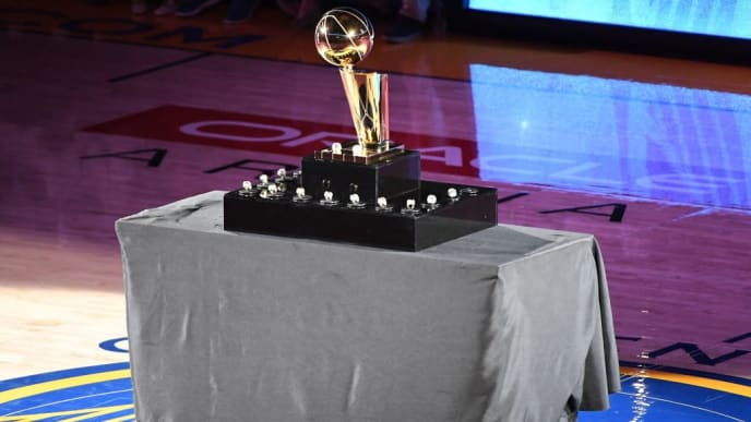 OAKLAND, CA - OCTOBER 16: A view of the Golden State Warriors 2017-2018 Championship rings and the Larry O'Brien NBA Championship Trophy prior to their game against the Oklahoma City Thunder at ORACLE Arena on October 16, 2018 in Oakland, California. NOTE TO USER: User expressly acknowledges and agrees that, by downloading and or using this photograph, User is consenting to the terms and conditions of the Getty Images License Agreement. (Photo by Robert Reiners/Getty Images)