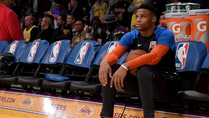 LOS ANGELES, CALIFORNIA - JANUARY 02:  Russell Westbrook #0 of the Oklahoma City Thunder sits on the bench alone before the game against the Los Angeles Lakers during a 107-100 Thunder win at Staples Center on January 02, 2019 in Los Angeles, California.  NOTE TO USER: User expressly acknowledges and agrees that, by downloading and or using this photograph, User is consenting to the terms and conditions of the Getty Images License Agreement. (Photo by Harry How/Getty Images)