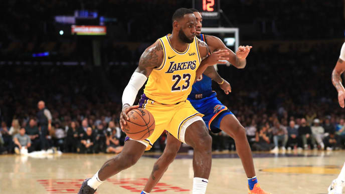 LOS ANGELES, CALIFORNIA - NOVEMBER 19:  LeBron James #23 of the Los Angeles Lakers dribbles past the defense of Terrance Ferguson #23 of the Oklahoma City Thunder during the second half of a game at Staples Center on November 19, 2019 in Los Angeles, California.  NOTE TO USER: User expressly acknowledges and agrees that, by downloading and/or using this photograph, user is consenting to the terms and conditions of the Getty Images License Agreement (Photo by Sean M. Haffey/Getty Images)