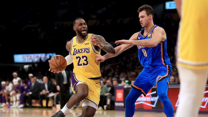 LOS ANGELES, CALIFORNIA - NOVEMBER 19:  LeBron James #23 of the Los Angeles Lakers dribbles past the defense of Danilo Gallinari #8 of the Oklahoma City Thunder during the second half of a game at Staples Center on November 19, 2019 in Los Angeles, California.  NOTE TO USER: User expressly acknowledges and agrees that, by downloading and/or using this photograph, user is consenting to the terms and conditions of the Getty Images License Agreement (Photo by Sean M. Haffey/Getty Images)