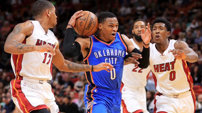 MIAMI, FL - DECEMBER 27:  Russell Westbrook #0 of the Oklahoma City Thunder drives on Josh Richardson #0 and Rodney McGruder #17 of the Miami Heat during a game  at American Airlines Arena on December 27, 2016 in Miami, Florida. NOTE TO USER: User expressly acknowledges and agrees that, by downloading and or using this photograph, User is consenting to the terms and conditions of the Getty Images License Agreement.  (Photo by Mike Ehrmann/Getty Images)
