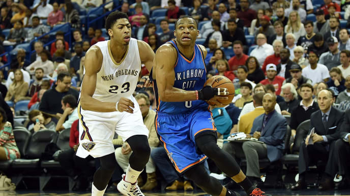 NEW ORLEANS, LA - DECEMBER 02:  Russell Westbrook #0 of the Oklahoma City Thunder drives around Anthony Davis #23 of the New Orleans Pelicans during the second quarter of a game at the Smoothie King Center on December 2, 2014 in New Orleans, Louisiana. New Orleans won the game 112-104. NOTE TO USER: User expressly acknowlesges and agrees that by downloading and or using this photograph, User is consenting to the terms and conditions of the Getty Images License Agreement.  (Photo by Stacy Revere/Getty Images)