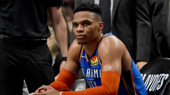 PORTLAND, OR - APRIL 16: Russell Westbrook #0 of the Oklahoma City Thunder looks on from the bench during the second half of Game Two of the Western Conference quarterfinals Portland Trail Blazers during the 2019 NBA Playoffs Moda Center on April 16, 2019 in Portland, Oregon. The Blazers won 114-94. NOTE TO USER: User expressly acknowledges and agrees that, by downloading and or using this photograph, User is consenting to the terms and conditions of the Getty Images License Agreement. (Photo by Steve Dykes/Getty Images)   (Photo by Steve Dykes/Getty Images)