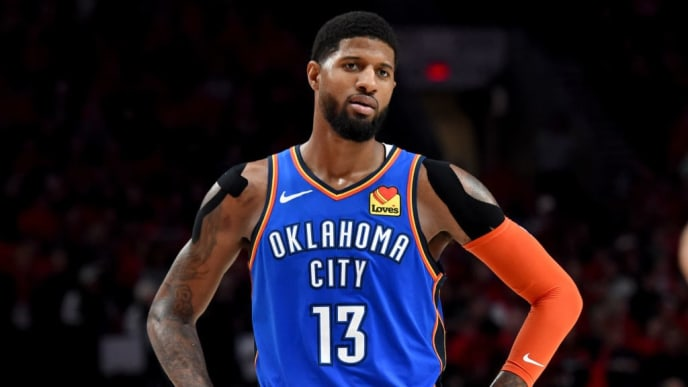 PORTLAND, OR - APRIL 16: Paul George #13 of the Oklahoma City Thunder reacts to an officials call during the second half of Game Two of the Western Conference quarterfinals against the Portland Trail Blazers during the 2019 NBA Playoffs Moda Center on April 16, 2019 in Portland, Oregon. The Blazers won 114-94. NOTE TO USER: User expressly acknowledges and agrees that, by downloading and or using this photograph, User is consenting to the terms and conditions of the Getty Images License Agreement. (Photo by Steve Dykes/Getty Images)   (Photo by Steve Dykes/Getty Images)