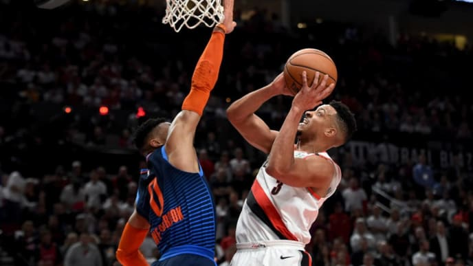 PORTLAND, OREGON - APRIL 23: CJ McCollum #3 of the Portland Trail Blazers drives to the basket on Russell Westbrook #0 of the Oklahoma City Thunder during the second half of Game Five of the Western Conference quarterfinals during the 2019 NBA Playoffs at Moda Center on April 23, 2019 in Portland, Oregon. The Blazers won 118-115.  NOTE TO USER: User expressly acknowledges and agrees that, by downloading and or using this photograph, User is consenting to the terms and conditions of the Getty Images License Agreement. (Photo by Steve Dykes/Getty Images)