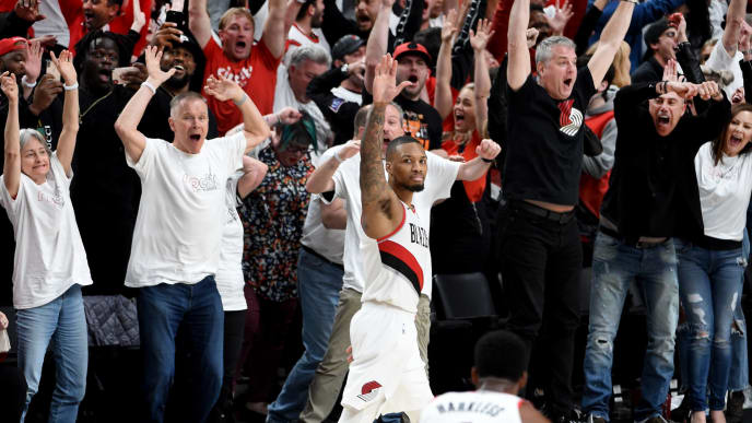 PORTLAND, OREGON - APRIL 23: Damian Lillard #0 of the Portland Trail Blazers waves goodbye to the Oklahoma City Thunder after hitting a last second 37 foot game winner to end Game Five of the Western Conference quarterfinals during the 2019 NBA Playoffs at Moda Center on April 23, 2019 in Portland, Oregon. The Blazers won 118-115.  NOTE TO USER: User expressly acknowledges and agrees that, by downloading and or using this photograph, User is consenting to the terms and conditions of the Getty Images License Agreement. (Photo by Steve Dykes/Getty Images)