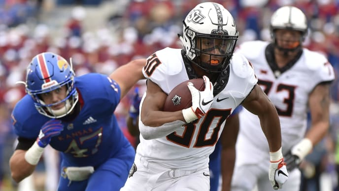 LAWRENCE, KS - SEPTEMBER 29: Running back Chuba Hubbard #30 of the Oklahoma State Cowboys runs for a 13-yard touchdown against the Kansas Jayhawks in the fourth quarter at Memorial Stadium on September 29, 2018 in Lawrence, Kansas. (Photo by Ed Zurga/Getty Images)
