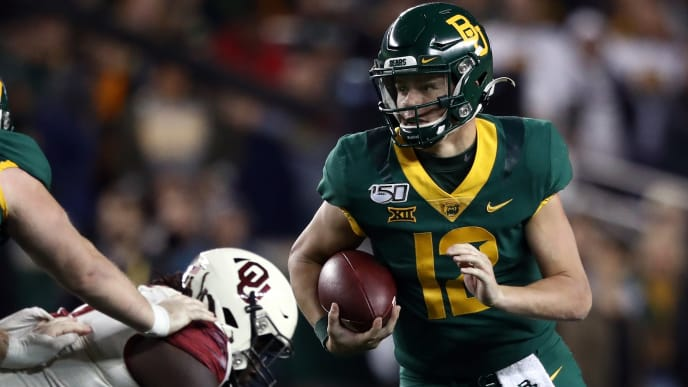 WACO, TEXAS - NOVEMBER 16:  Charlie Brewer #12 of the Baylor Bears runs the ball against the Oklahoma Sooners in the first half at McLane Stadium on November 16, 2019 in Waco, Texas. (Photo by Ronald Martinez/Getty Images)