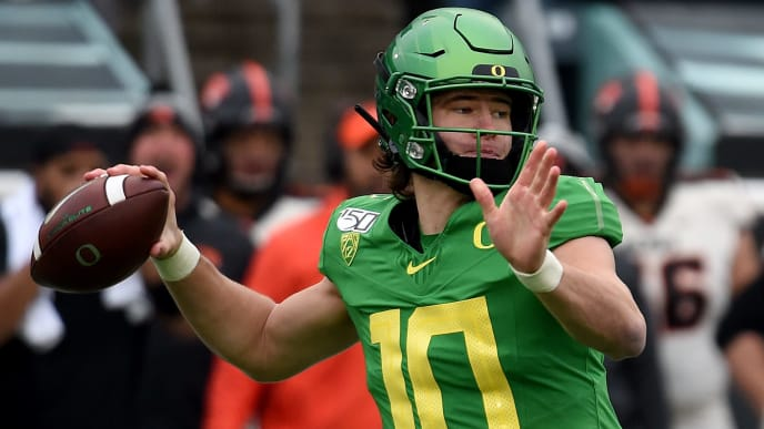 Justin Herbert and the Oregon Ducks take on the Utah Utes in the Pac-12 Championship on Friday.