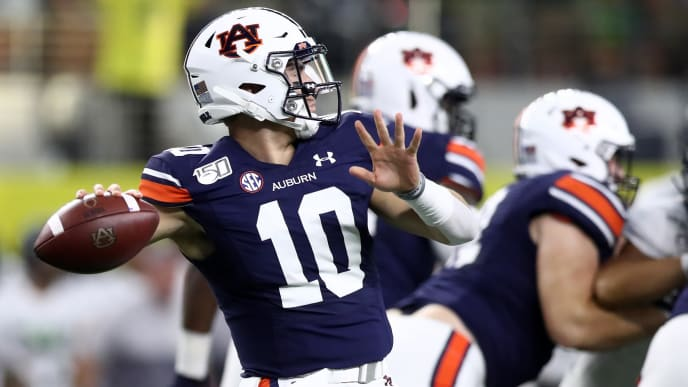 ARLINGTON, TEXAS - AUGUST 31:   Bo Nix #10 of the Auburn Tigers throws the ball against the Oregon Ducks during the Advocare Classic at AT&T Stadium on August 31, 2019 in Arlington, Texas. (Photo by Ronald Martinez/Getty Images)
