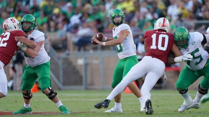 PALO ALTO, CA - SEPTEMBER 21:  Justin Herbert #10 of the Oregon Ducks drops back to pass against the Stanford Cardinal during the fourth quarter of an NCAA football game at Stanford Stadium on September 21, 2019 in Palo Alto, California. Oregon won the game 21-6. (Photo by Thearon W. Henderson/Getty Images)