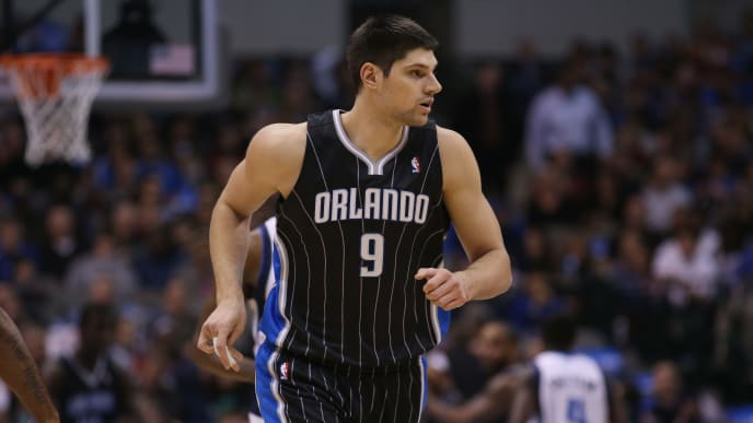 DALLAS, TX - FEBRUARY 20:  Nikola Vucevic #9 of the Orlando Magic at American Airlines Center on February 20, 2013 in Dallas, Texas.  NOTE TO USER: User expressly acknowledges and agrees that, by downloading and or using this photograph, User is consenting to the terms and conditions of the Getty Images License Agreement.  (Photo by Ronald Martinez/Getty Images)