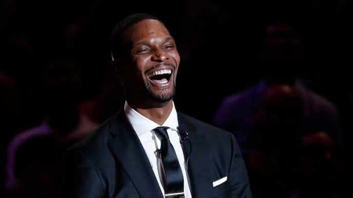 MIAMI, FLORIDA - MARCH 26:  Former Miami Heat player Chris Bosh reacts during his jersey retirement ceremony at halftime of the game between the Miami Heat and the Orlando Magic at American Airlines Arena on March 26, 2019 in Miami, Florida. NOTE TO USER: User expressly acknowledges and agrees that, by downloading and or using this photograph, User is consenting to the terms and conditions of the Getty Images License Agreement. (Photo by Michael Reaves/Getty Images)