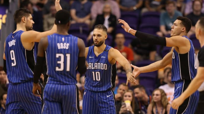 PHOENIX, AZ - NOVEMBER 10:  Aaron Gordon #00 (R) of the Orlando Magic high fives Nikola Vucevic #9, Terrence Ross #31 and Evan Fournier #10 after scoring against the Phoenix Suns during the second half of the NBA game at Talking Stick Resort Arena on November 10, 2017 in Phoenix, Arizona. NOTE TO USER: User expressly acknowledges and agrees that, by downloading and or using this photograph, User is consenting to the terms and conditions of the Getty Images License Agreement.  (Photo by Christian Petersen/Getty Images)