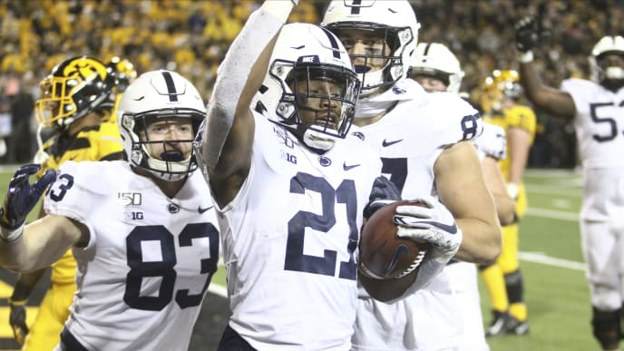 IOWA CITY, IOWA- OCTOBER 12:  Running back Noah Cain #21 of the Penn State Nittany Lions celebrates a touchdown with tight ends Nick Bowers and Pat Freiermuth #87 in the second half against the Iowa Hawkeyes, on October 12, 2019 at Kinnick Stadium in Iowa City, Iowa.  (Photo by Matthew Holst/Getty Images)