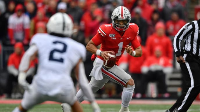 COLUMBUS, OH - NOVEMBER 23:  Quarterback Justin Fields #1 of the Ohio State Buckeyes runs with the ball against the Penn State Nittany Lions at Ohio Stadium on November 23, 2019 in Columbus, Ohio.  (Photo by Jamie Sabau/Getty Images)