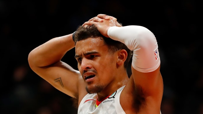 ATLANTA, GEORGIA - OCTOBER 28:  Trae Young #11 of the Atlanta Hawks reacts to a call in the first half against the Philadelphia 76ers at State Farm Arena on October 28, 2019 in Atlanta, Georgia.  NOTE TO USER: User expressly acknowledges and agrees that, by downloading and/or using this photograph, user is consenting to the terms and conditions of the Getty Images License Agreement.  (Photo by Kevin C. Cox/Getty Images)
