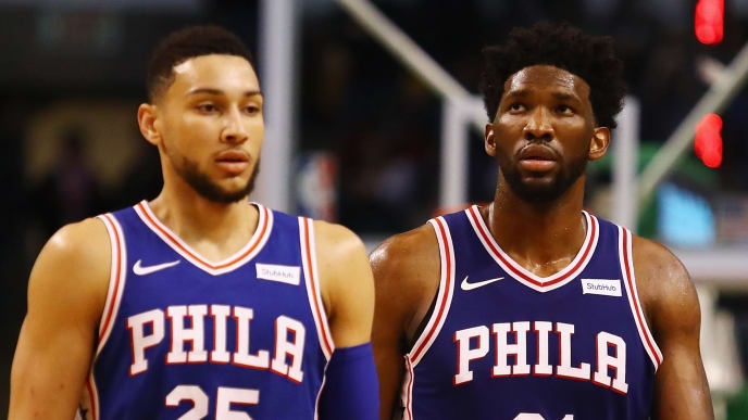 BOSTON, MA - JANUARY 18:  Ben Simmons #25 and Joel Embiid #21 of the Philadelphia 76ers walk off the court during a time out in the second half against the Boston Celtics at TD Garden on January 18, 2018 in Boston, Massachusetts.  (Photo by Tim Bradbury/Getty Images)