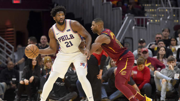 CLEVELAND, OHIO - NOVEMBER 17: Joel Embiid #21 of the Philadelphia 76ers passes around Tristan Thompson #13 of the Cleveland Cavaliers during the first half at Rocket Mortgage Fieldhouse on November 17, 2019 in Cleveland, Ohio. NOTE TO USER: User expressly acknowledges and agrees that, by downloading and/or using this photograph, user is consenting to the terms and conditions of the Getty Images License Agreement. (Photo by Jason Miller/Getty Images)